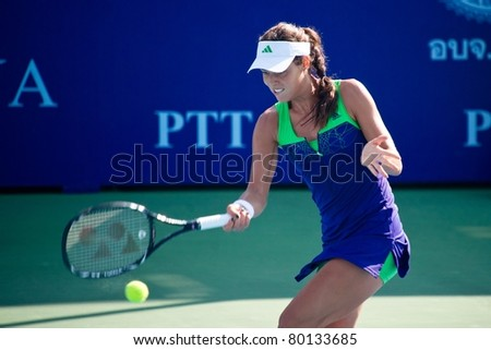 PATTAYA, THAILAND - FEBRUARY 8: Serbian tennis player Ana Ivanovic in action during round 1 of PTT Pattaya Open on February 8, 2011 at Dusit Thani Hotel in Pattaya, Thailand - stock photo