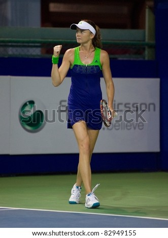 PATTAYA THAILAND - FEBRUARY 12: Slovakian player Daniela Hantuchova reacts after winning a point during semi-final of PTT Pattaya Open on February 12, 2011 at Dusit Thani Hotel in Pattaya, Thailand - stock photo