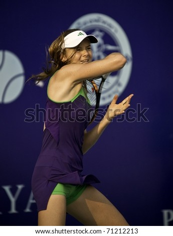 PATTAYA THAILAND - FEBRUARY 13: Slovakian tennis player Daniela Hantuchova in action during the final against Sara Errani of Italy at PTT Pattaya Open at Dusit Thani Hotel in Pattaya, Thailand - stock photo
