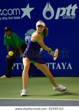 PATTAYA THAILAND - FEBRUARY 12: Slovakian tennis player Daniela Hantuchova returns the ball during semi-final round of PTT Pattaya Open on February 12, 2011 at Dusit Thani Hotel in Pattaya, Thailand - stock photo