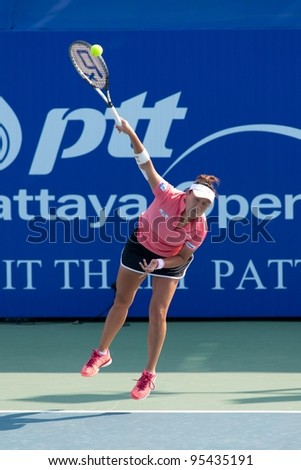 PATTAYA, THAILAND - FEBRUARY 8: Tamarine Tanasugarn of Thailand takes her serve during Round 2 of PTT Pattaya Open 2012 on February 8, 2012 at Dusit Thani Hotel in Pattaya, Thailand