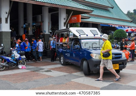 PATTAYA,THAILAND - FEBRUARY 23,2013:Tourists in front of the ticket office of the ferry on the Central beach