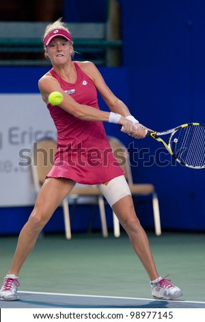 PATTAYA THAILAND - FEBRUARY 9: Urszula Radwanska of Poland returns a ball during Round 2 of PTT Pattaya Open 2012 on February 9, 2012 at Dusit Thani Hotel in Pattaya, Thailand - stock photo