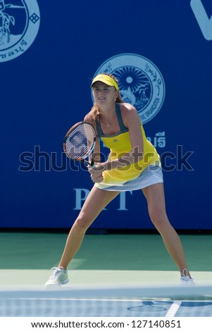 PATTAYA THAILAND - JANUARY 31: Daniela Hantuchova of Slovakia prepares to return a serve during 1st round of PTT Pattaya Open 2013, January 31, 2013 at Dusit Thani Hotel in Pattaya, Thailand - stock photo