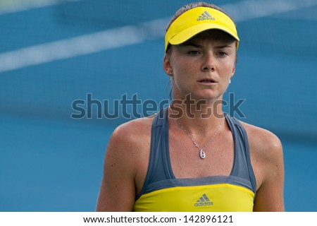 PATTAYA THAILAND - JANUARY 31: Daniela Hantuchova of Slovakia prepares to serve during 1st round of PTT Pattaya Open 2013 on January 31, 2013 at Dusit Thani Hotel in Pattaya, Thailand - stock photo