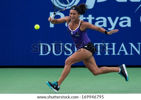 PATTAYA THAILAND - JANUARY 31: Heather Watson of Great Britain returns a ball during 1st round of PTT Pattaya Open 2013 on January 31, 2013 at Dusit Thani Hotel in Pattaya, Thailand - stock photo