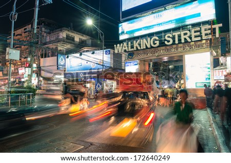 PATTAYA, THAILAND - JANUARY 19, 2014: the beginning of the Walking Street of Pattaya. The street runs from the south end of Beach Road to the Bali Hai Pier and is closed to the traffic after 6pm. - stock photo