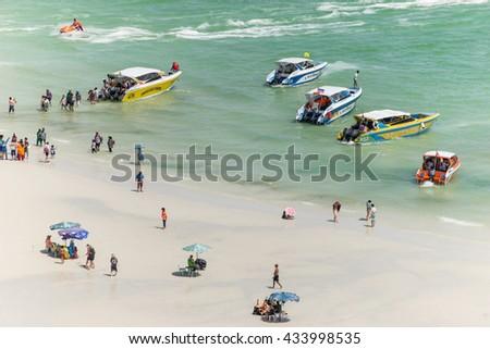 PATTAYA,THAILAND - 08 JUNE 2016 : speed boat parking on Koh Larn Island shore  waiting tourist back to Pattaya City, Pattaya city famous tourist attraction of Thailand. - stock photo