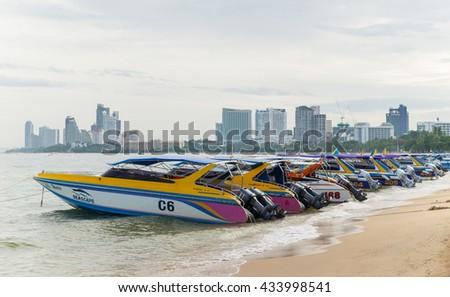 PATTAYA,THAILAND - 08 JUNE 2016 : speed boat parking on Pattaya bay waiting tourist for Koh Larn Island, Pattaya city famous tourist attraction of Thailand. - stock photo