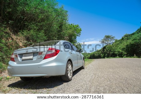 PATTAYA,THAILAND - JUNE 15 : The honda civic on the road up to the hill on sea shore in summer at June 15, 2015 in countryside of Pattaya,Thailand