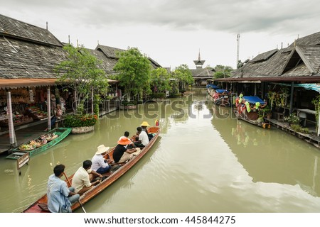 PATTAYA,THAILAND - 22 JUNE 2016 : Tourist  shopping and Scenic boat ride in Pattaya Floating Market, Pattaya city famous tourist attraction of Thailand. - stock photo