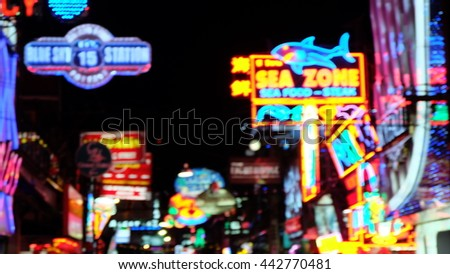 PATTAYA, THAILAND - May 28, 2016: multicolored neon signs and blurred people on the new Walking Street of the city - The road is closed to the traffic after 6pm and stays crowded until late night