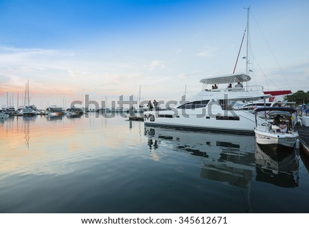 PATTAYA, THAILAND - NOVEMBER 29 : The sailing boats and skyscraper in Marina yacht club Pattaya in twilight time on November 29, 2015 in Pattaya, Thailand