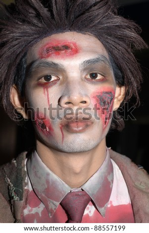 PATTAYA , THAILAND - OCTOBER 31 : Thai man celebrates Halloween on October 31 2011 in Pattaya, Thailand. Halloween has become popular in Thailand in recent years .