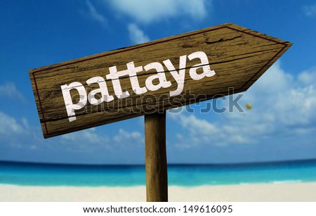 Pattaya wooden sign with a beach on background - stock photo