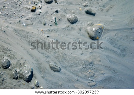 Pattern and design of mud and silt flow in stream. - stock photo