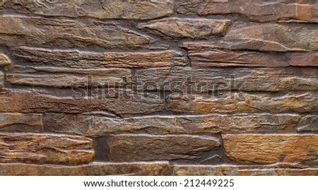 pattern brown color of modern style design decorative uneven cracked real stone wall surface with cement - stock photo