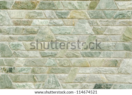 pattern color of modern style  design decorative  green slate stone wall surface with cement in trapezoid shape - stock photo