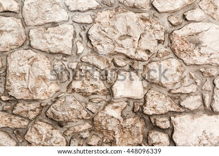 pattern color of modern style design decorative uneven, real stone wall surface with cement - stock photo