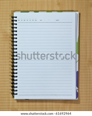 Pattern cover of open white note book on wood background