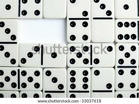 Pattern formed by white bones of a dominoes with hole