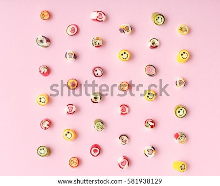 Pattern lollipops, candy on colorful pink background, top view flat lay. Sweet sucker, lollipop, candy, isolated minimal concept above decoration, food background