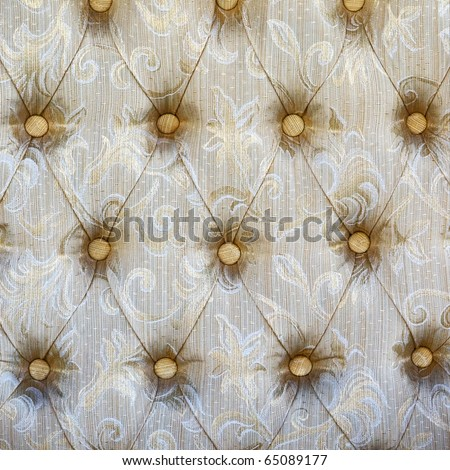 Pattern of a furniture upholstery tapestry texture.Light-beige color with white and dark-beige graphical floral ornament. - stock photo