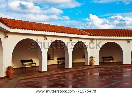 Pattern Of A Modern Covered Arcade With Ceramic Floor And Tile Roof On Blue  Sky Background