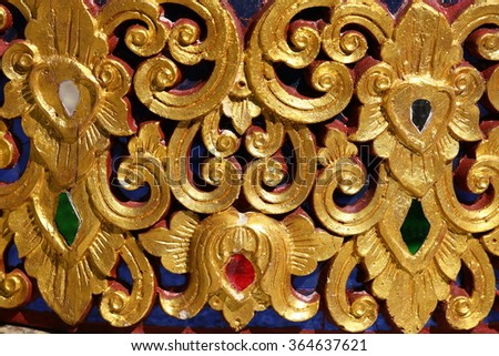 Pattern of carved on wood background on the wall of temple Thailand