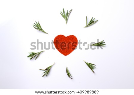 pattern of chili and rosemary on a white background in the form of heart - stock photo