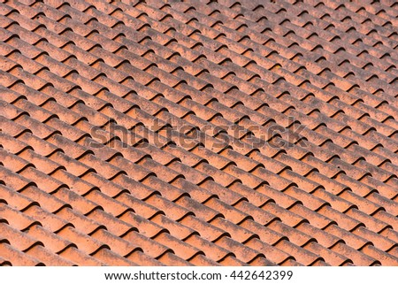Pattern of clay roof tiles in detail - stock photo