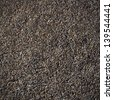 Pattern of dark gravel surface - stock photo