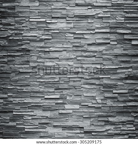 pattern of decorative black slate stone wall surface - stock photo