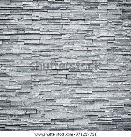 pattern of decorative black slate stone wall surface / black stone - stock photo