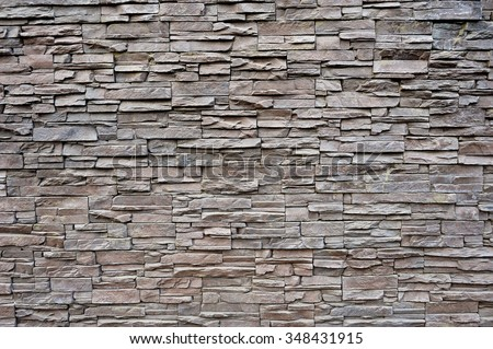 pattern of decorative brown grey slate stone wall surface - stock photo