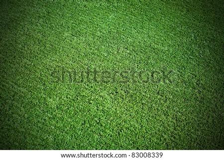 Pattern of decorative green football grass - stock photo