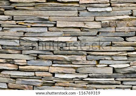 pattern of decorative slate stone wall surface - stock photo