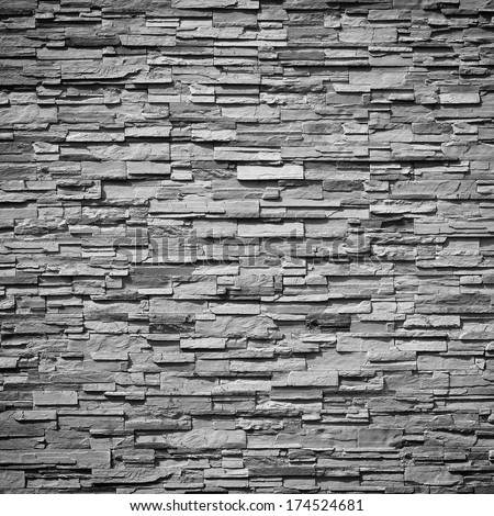 pattern of decorative slate stone wall surface - stock photo