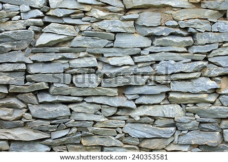 pattern of decorative stone wall background - stock photo