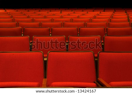 Pattern of empty red seats - stock photo