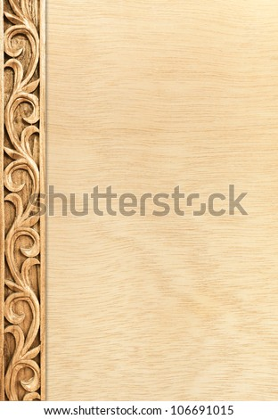 Pattern of flower carved frame on wood background - stock photo