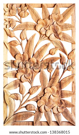 Pattern of flower carved isolated on wood - stock photo