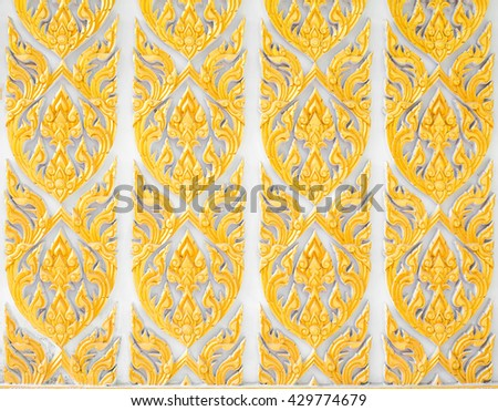 Pattern of flower carved on cement - stock photo