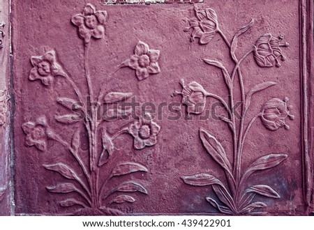 Pattern of flower carved on wall