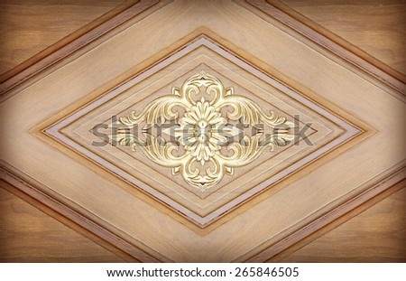 Pattern of flower carved on wood background - stock photo