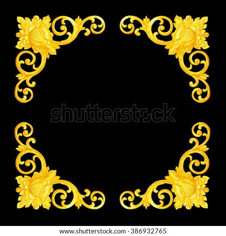 Pattern of flower carved on wood for decoration isolated on black background; Pattern of flower carved frame on black  background - stock photo