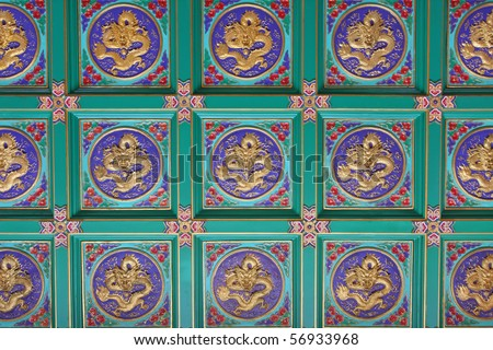 Pattern of golden dragon in chinese style. On ceiling.