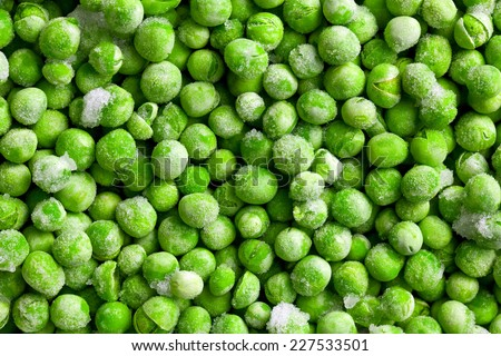 pattern of green frozen peas - stock photo