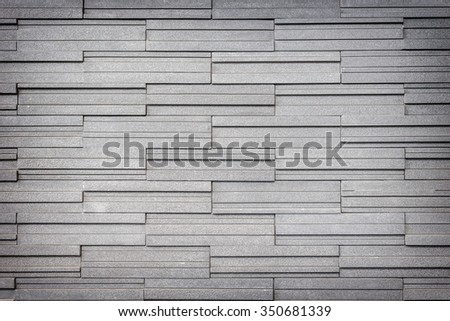 Pattern of grey and rough granite wall texture and background - stock photo
