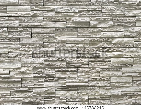 Pattern of grey and rough sandstone wall texture